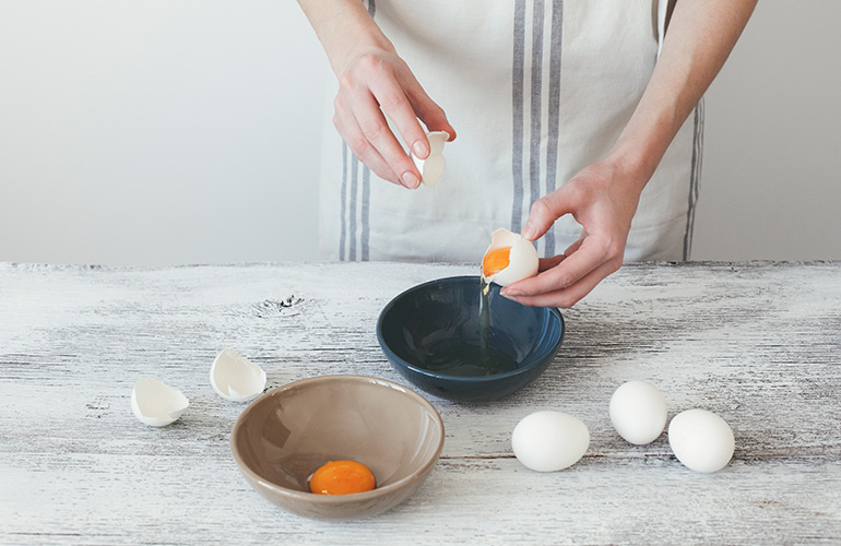 Use eggshells to separate egg whites from yolks