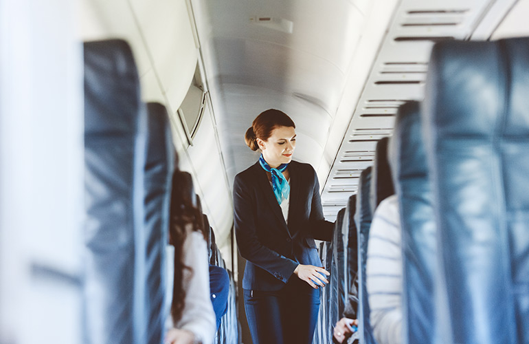 How do flight attendants deal with unruly passengers?