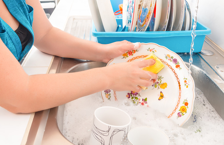 Not cleaning or overcleaning dishes before loading them